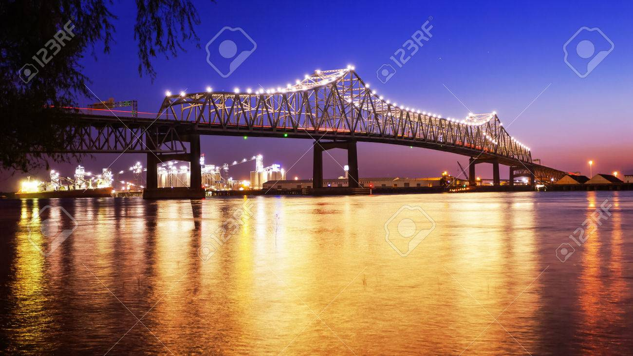 Horace Wilkinson Bridge crosses over the Mississippi River at night in Baton Rouge, Louisiana - 60966795