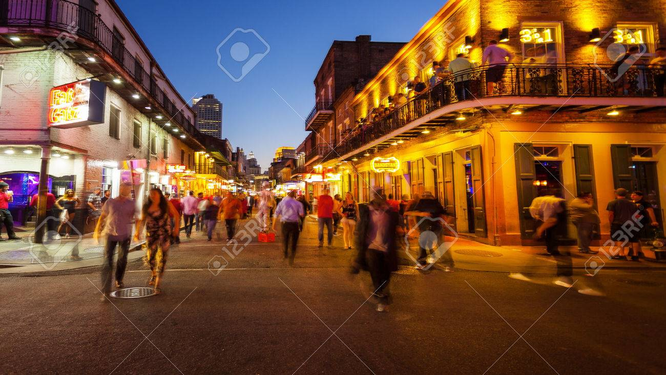 Bourbon Street in the French Quarter of New Orleans as night falls and the lights come on - 62871193