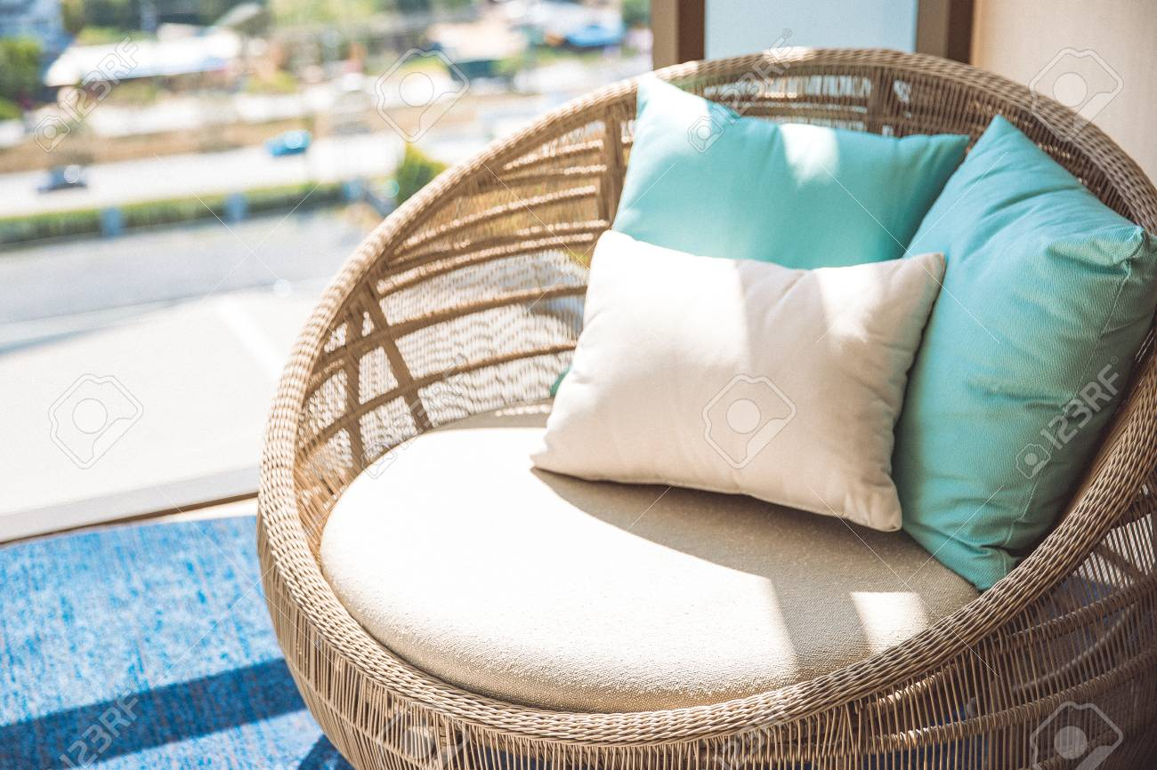 Superieur Round Wicker Wood Chair With White Cushion And Comfort Pillows. Near By The  Window And