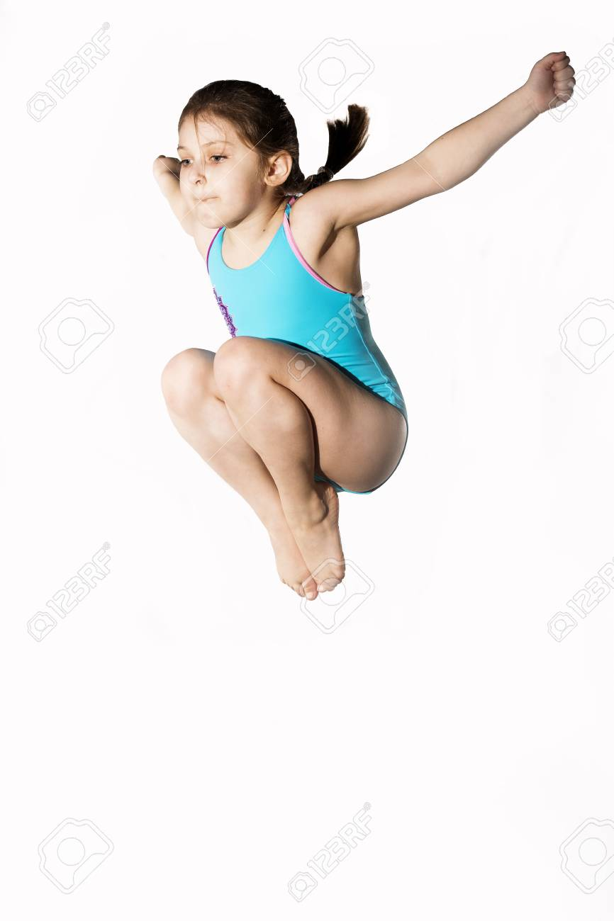 Little caucasian female 7 years old girl in cyan swimming costume