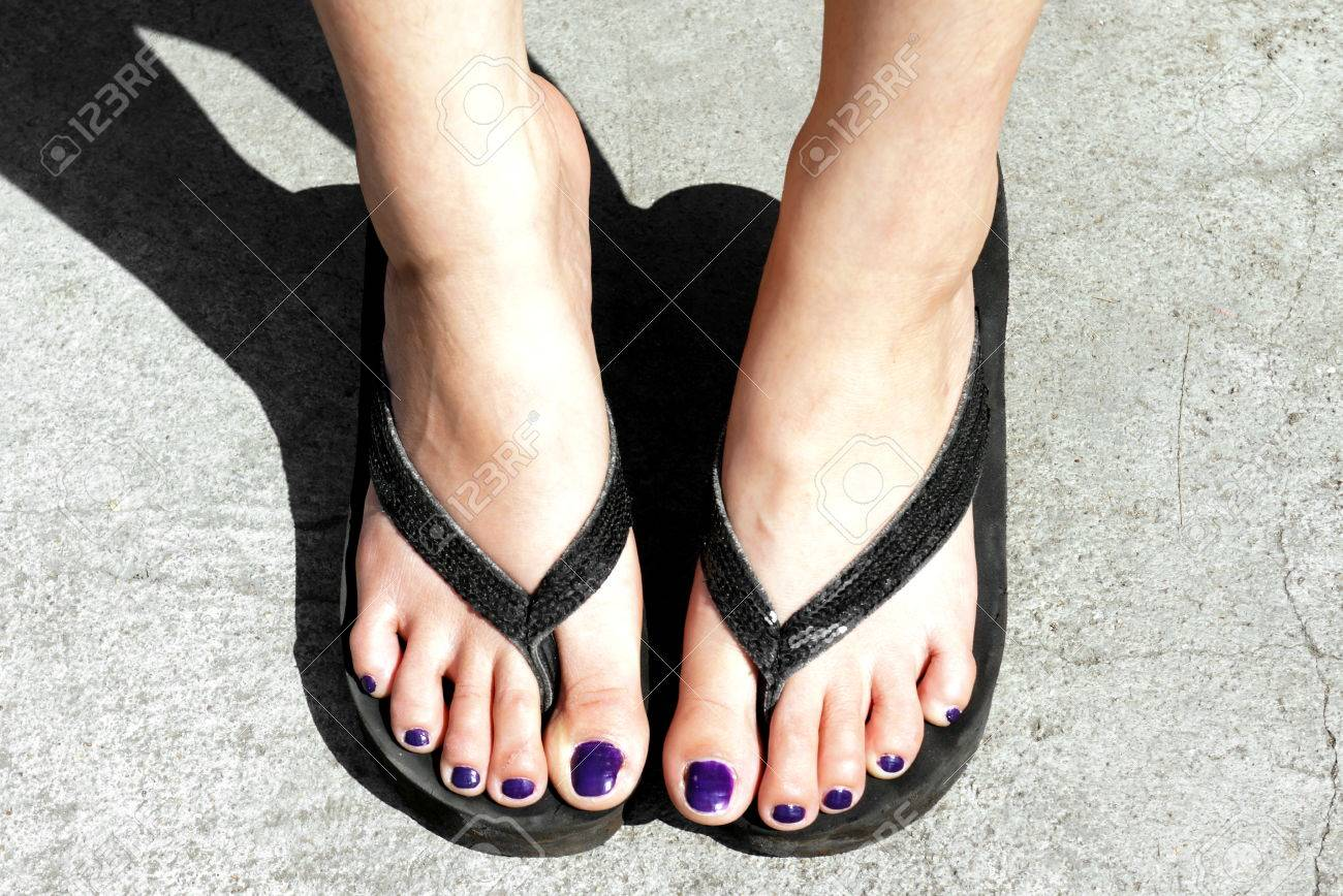 afd0989e3974 Close up of girl feet wearing flip flops Stock Photo - 48885106