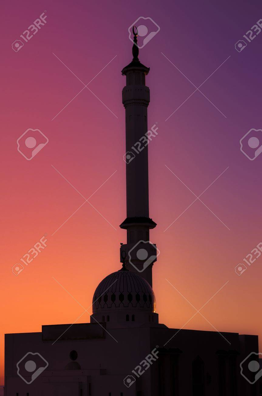 A silhouette mosque with a symbolic sunset- light vs dark - day vs night Stock Photo - 13659958