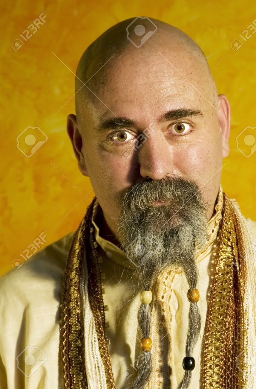 Funny bald guru with a long beaded beard. Stock Photo - 1525926