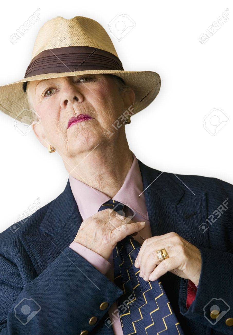 Woman Wearing A Man s Hat And Suit Adjusting Her Tie. Stock Photo ... e4ee7f23cc1