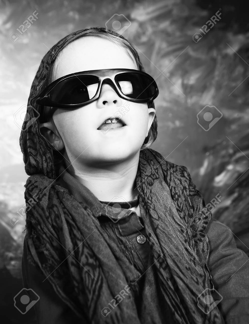 Little girl with sunglasses in a studio Stock Photo - 2703859