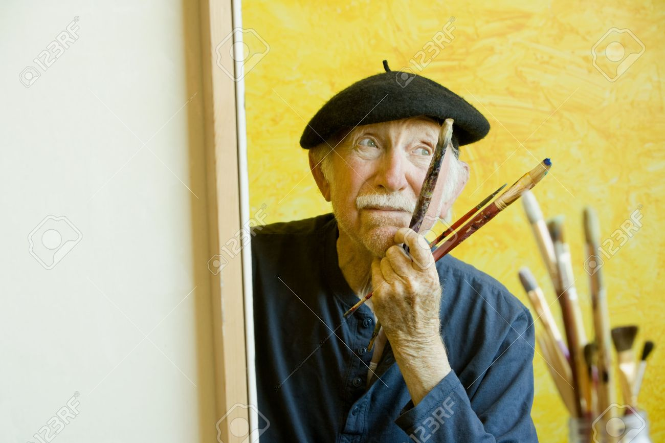 cdd9c2944c74a Elderly painter wearing a beret working on a large canvas Stock Photo -  3108959