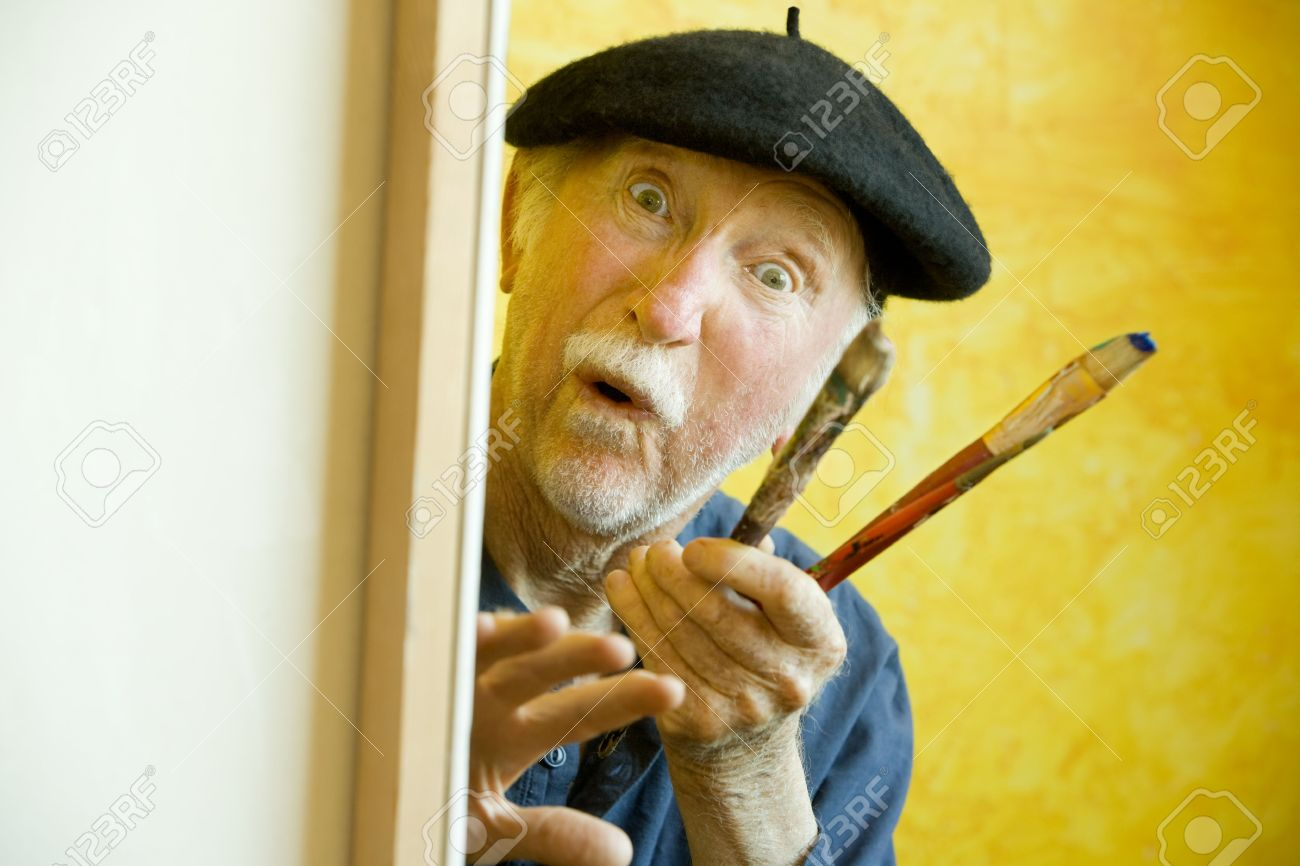 c24da221cf445 Elderly painter wearing a beret working on a large canvas and looking up  Stock Photo -