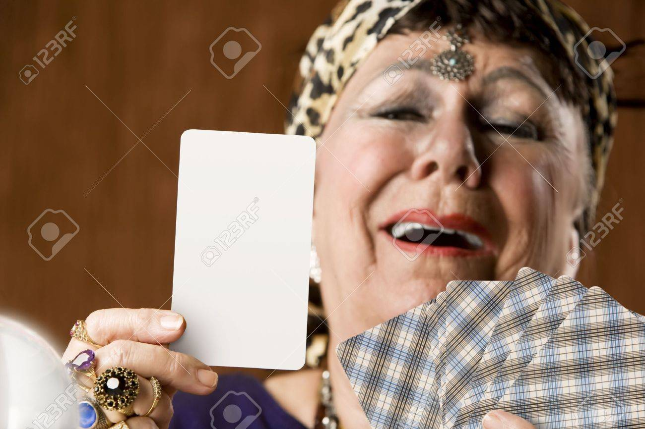 Gypsy fortune teller hiolding a blank tarot card Stock Photo - 3550151
