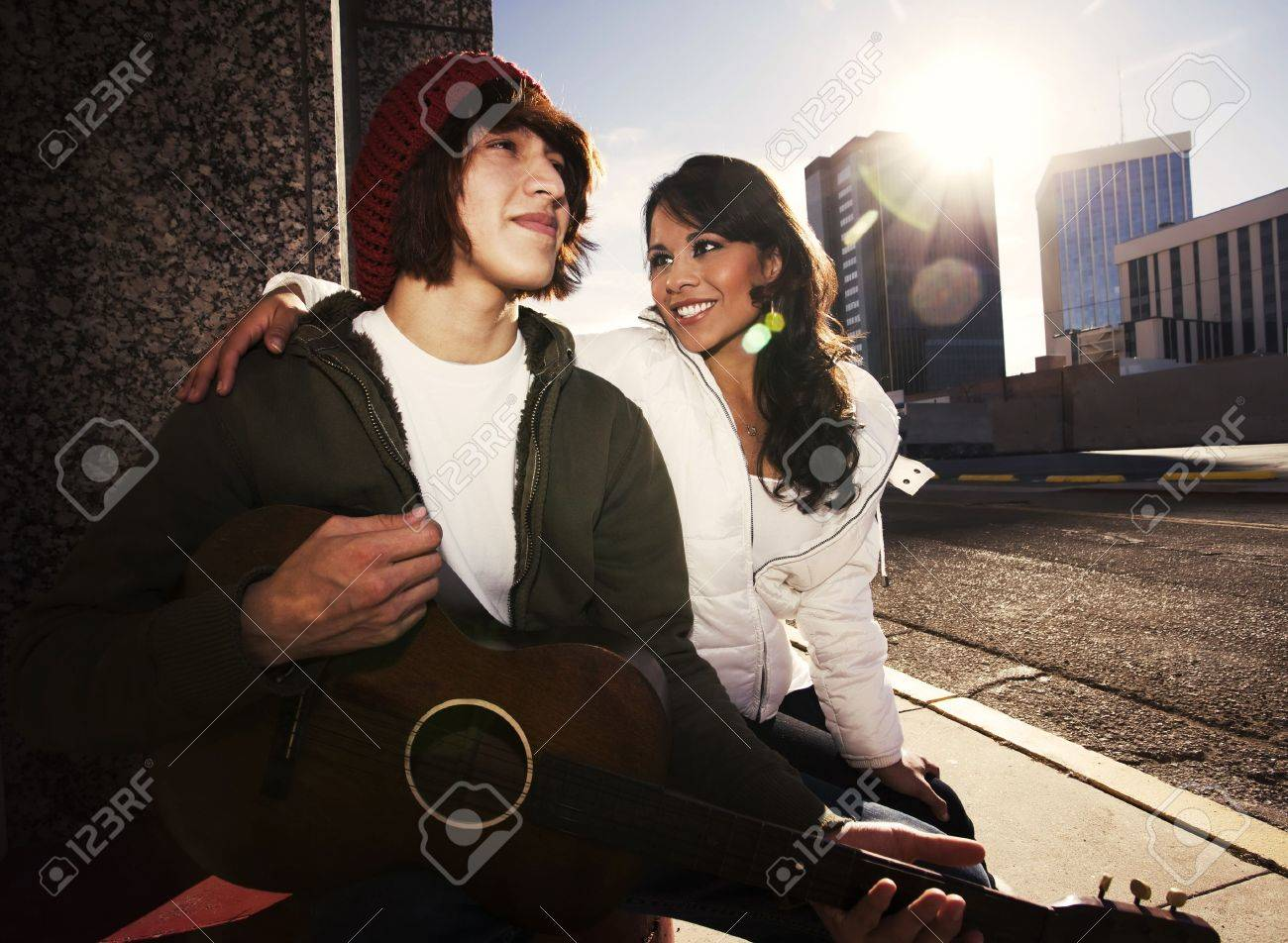 Hispanic Musician And Latina Girlfriend Downtown At Sundown Stock Photo 4103856