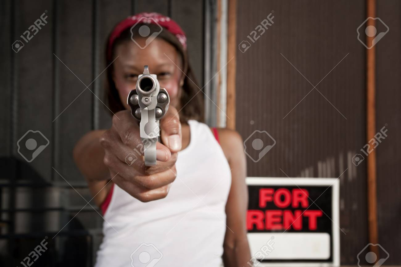 African american woman with a gun on her front porch stock photo 4578006
