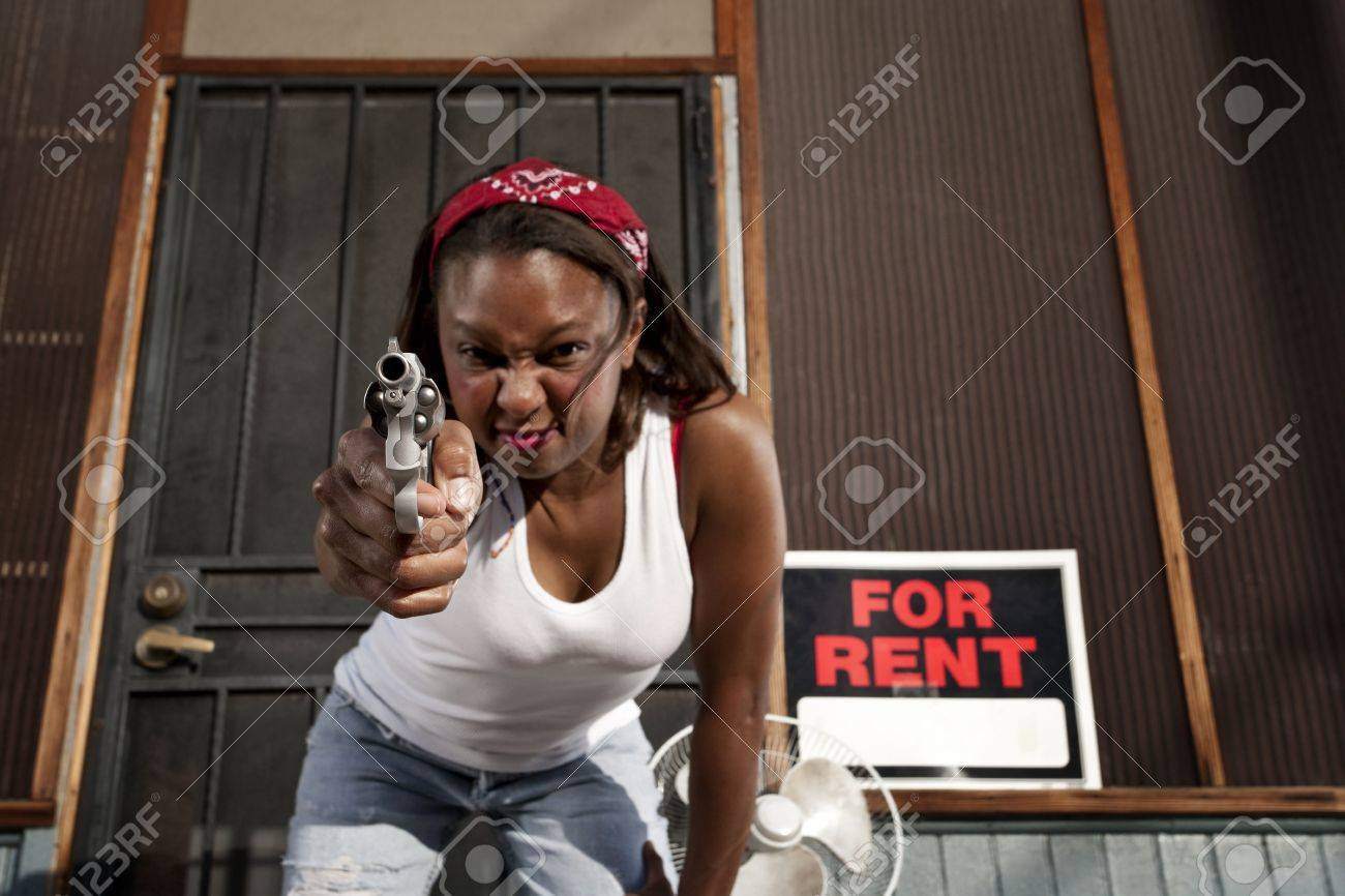 African american woman with a gun on her front porch stock photo 4578003