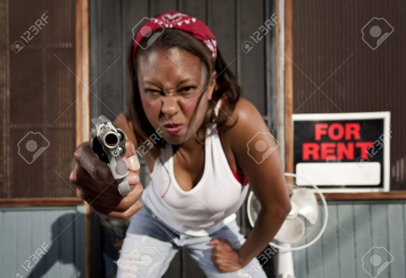 African american woman with a gun on her front porch stock photo 4578022