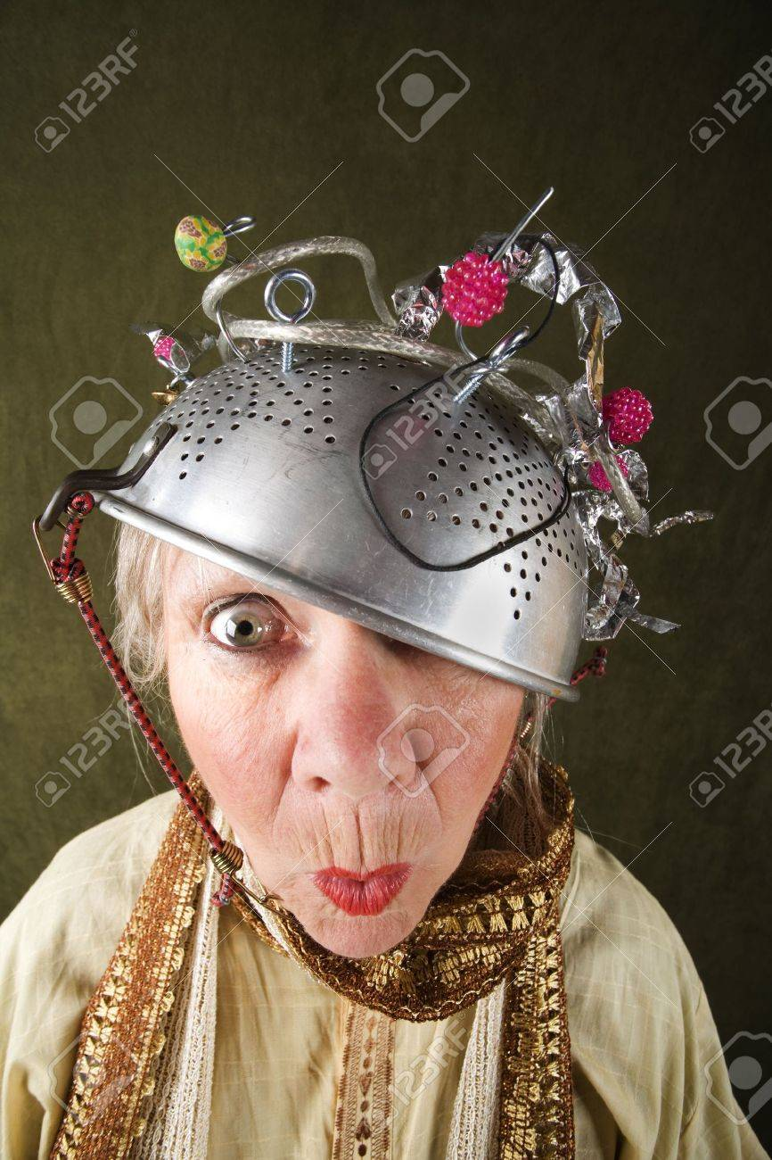 Crazy woman wearing a metal colander for a helmet - 4618596