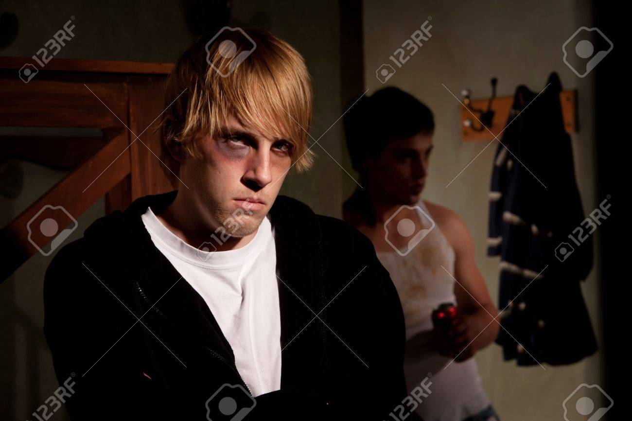 Frightened young man with menacing alcoholic Stock Photo - 6662496