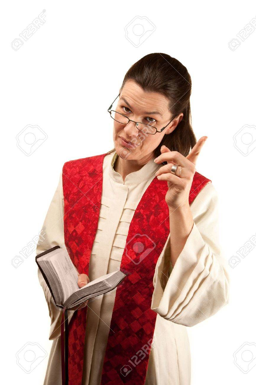 Pastor In White Robes With Bible And Red Stole Stock Photo Picture And Royalty Free Image Image 6662585