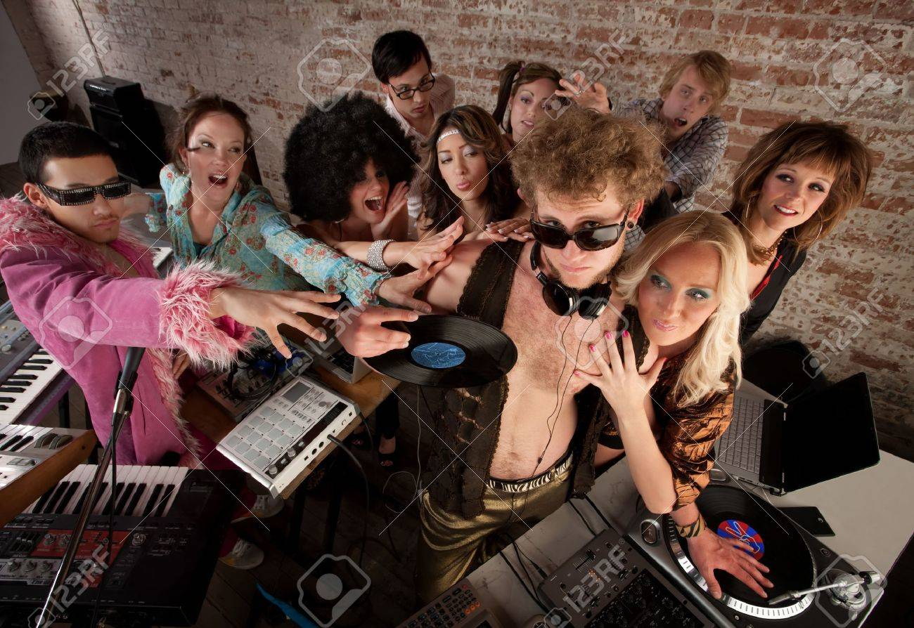 Famous DJ crowded by fans and requests at a party Stock Photo - 7478696