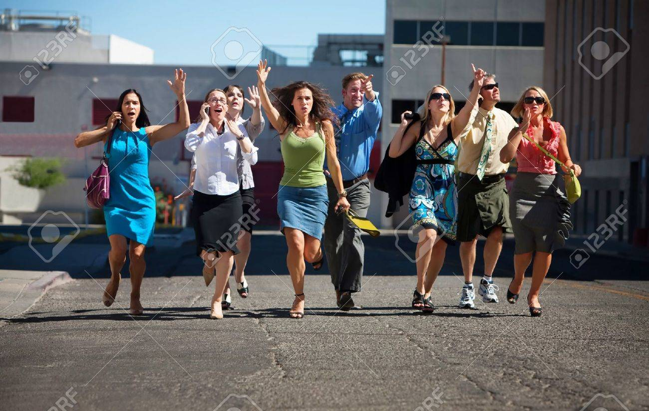 Group of hard working business men and women run down city street. Stock Photo - 7566835