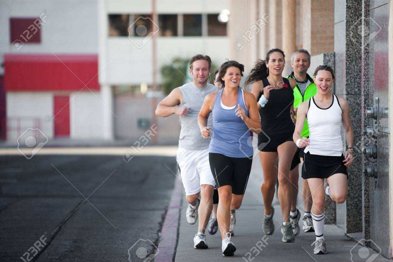 Men and women running for exercise downtown Stock Photo - 7622833