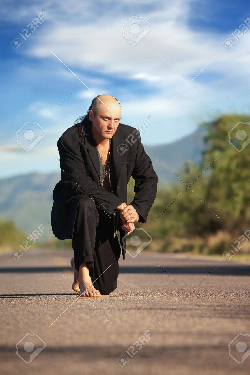 Strange indigenous man in the middle of a road Stock Photo - 7955909