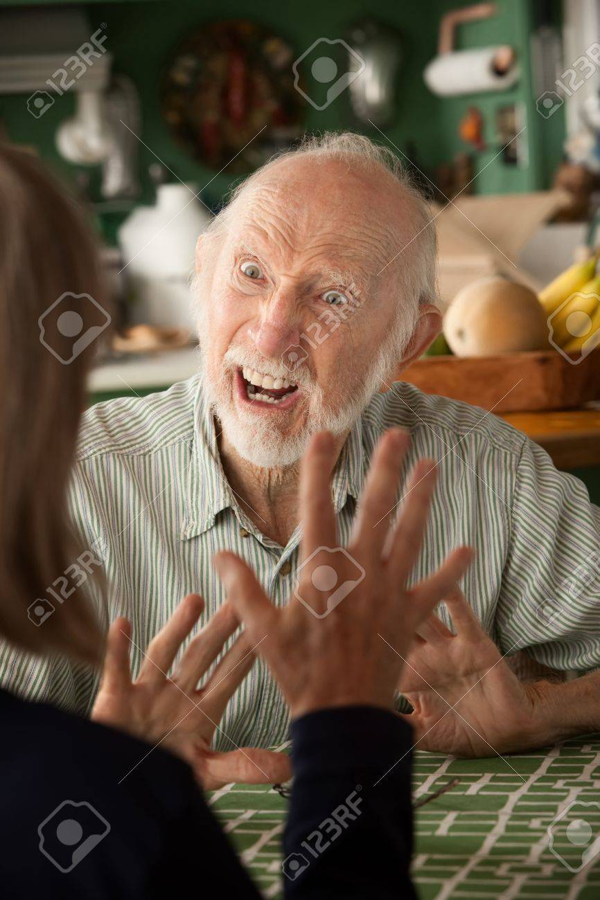 Senior couple at home in kitchen focusing on angry man Stock Photo - 7934711
