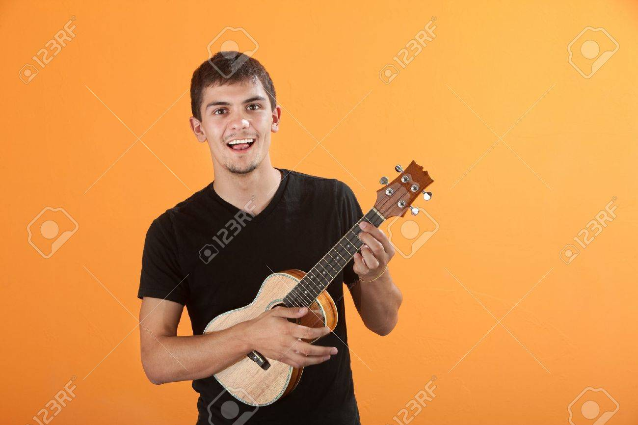 Happy Native American teen playing a ukulel Stock Photo - 9136824