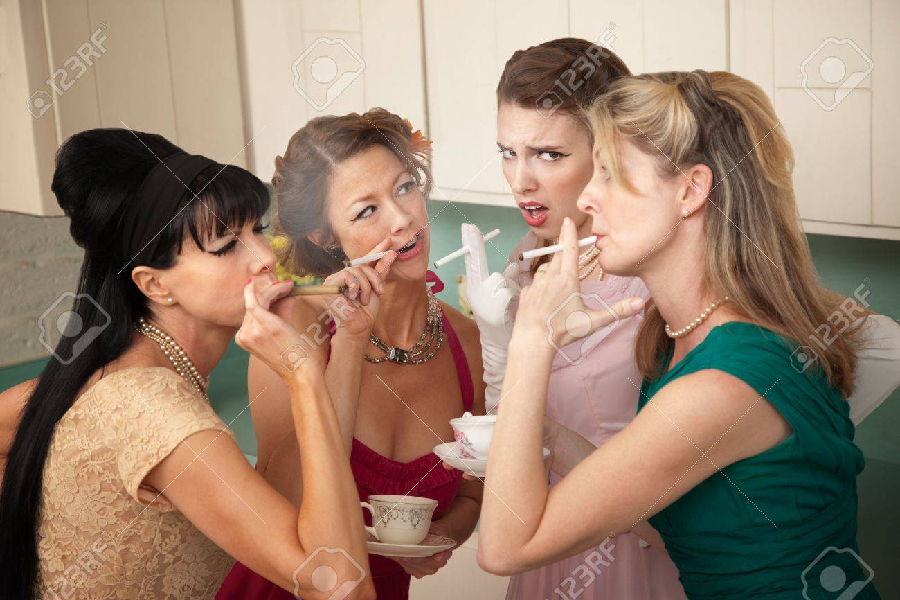 Unsure young woman around older ladies smoking in the kitchen Stock Photo - 9270002