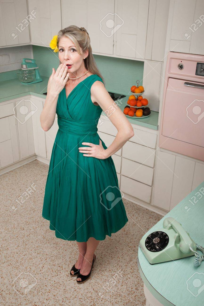 Forgetful Middle-aged Caucasian Woman With Hand On Hip In Retro ...