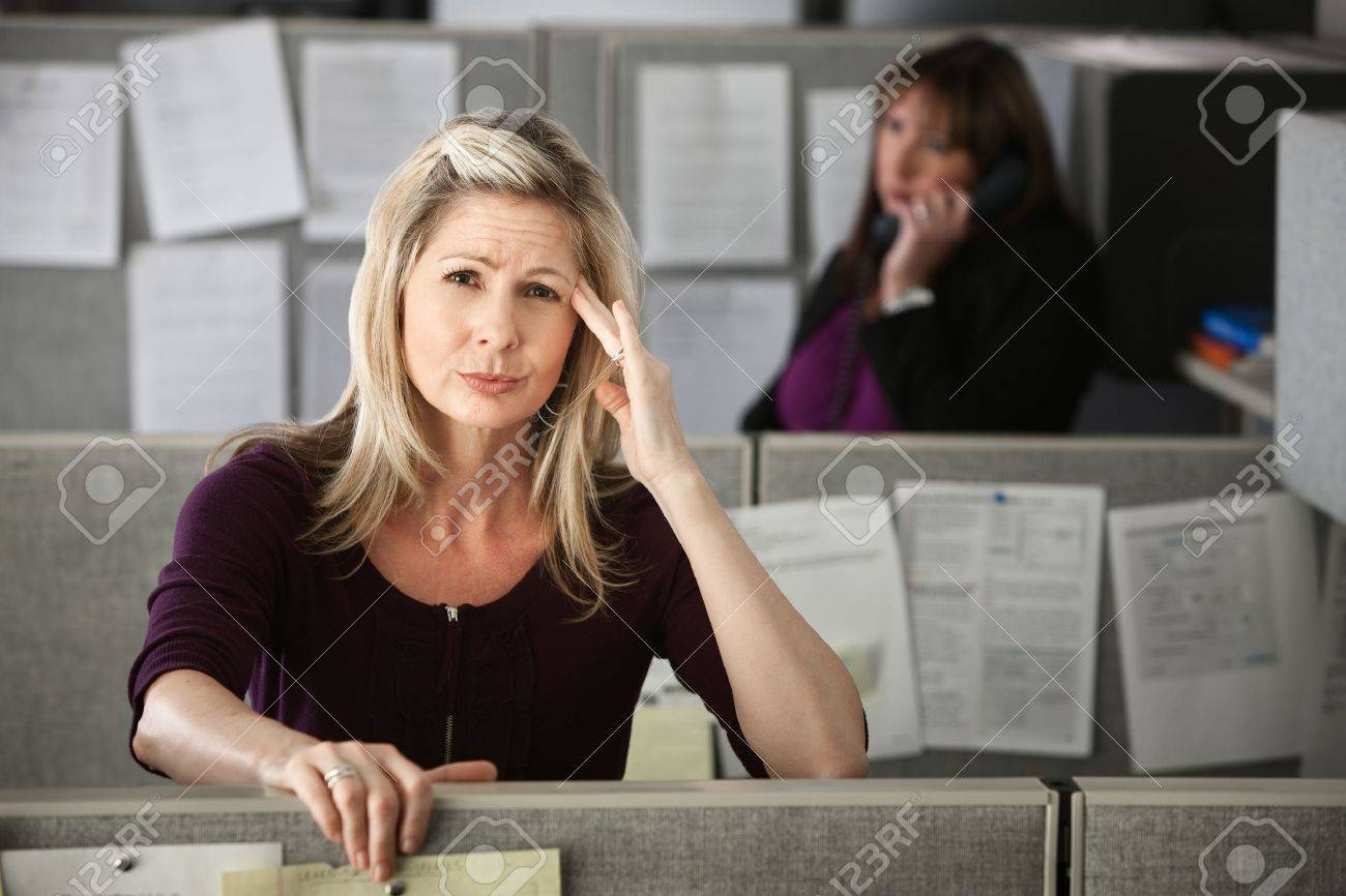 Stressed-out office worker with hand on her head Stock Photo - 9737858