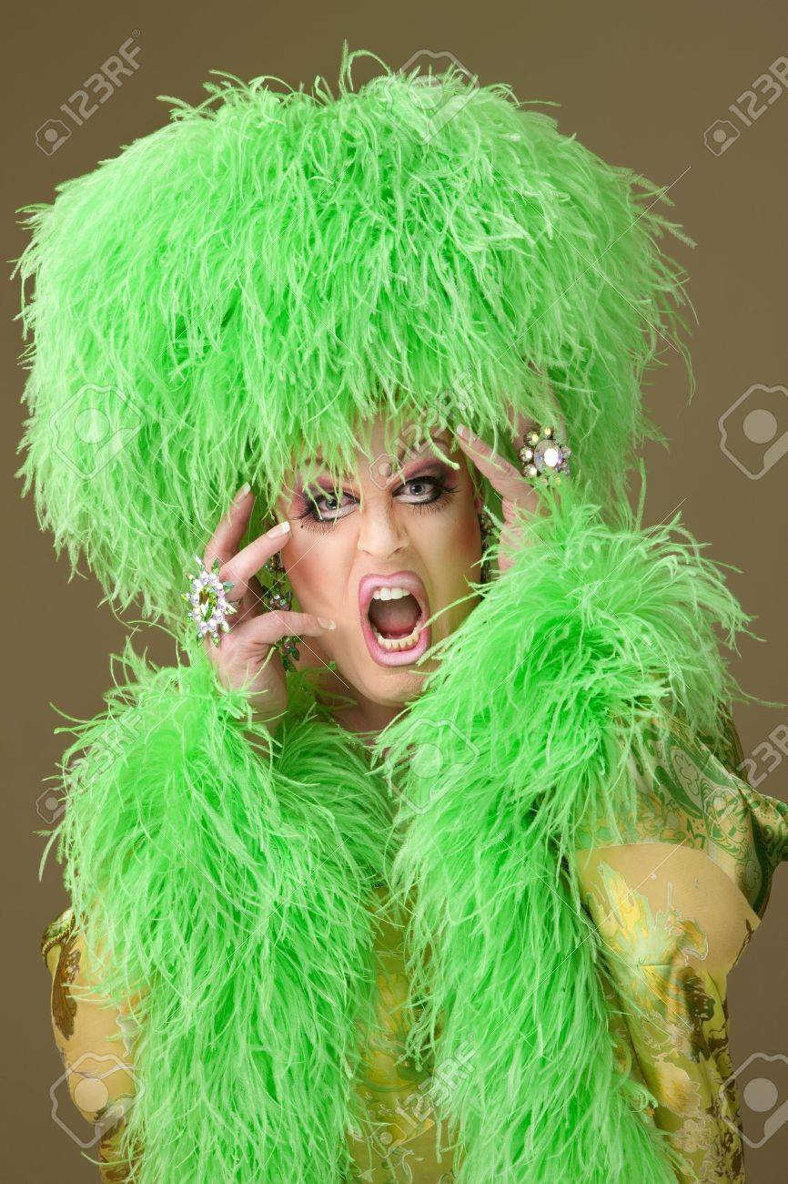 Large woman wearing heavy makeup and boa hat on green background Stock Photo - 9738372