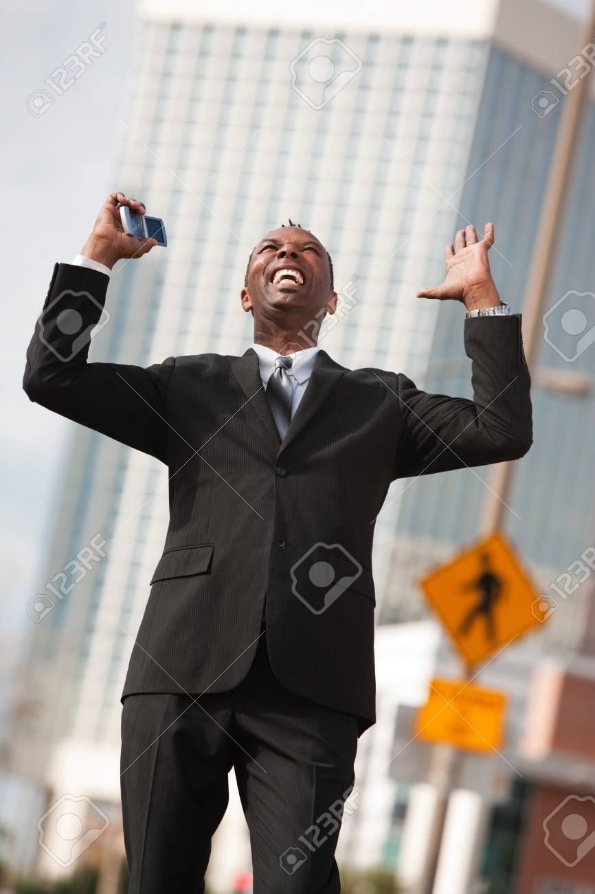 Excited African-American businessman with raised arms Stock Photo - 10553189