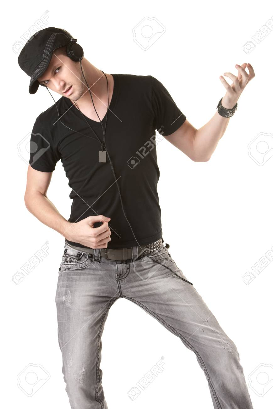 Young Caucasian listens to music on headphones over white background Stock Photo - 10553165