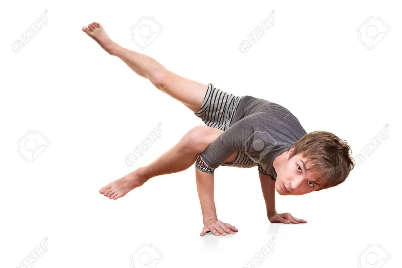 Young man in Koundinyasana posture over white background Stock Photo - 10553238