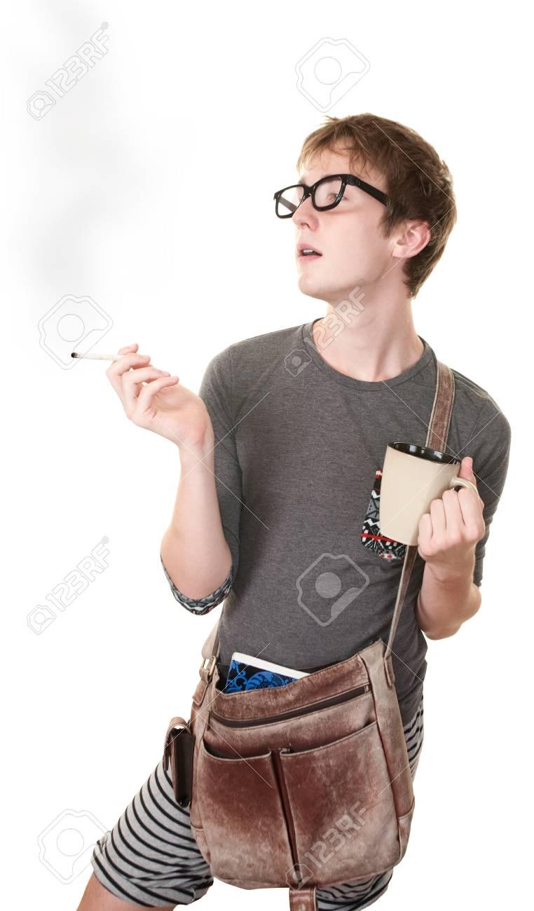 Teen with messenger bag and mug smokes a cigarette Stock Photo - 10553356