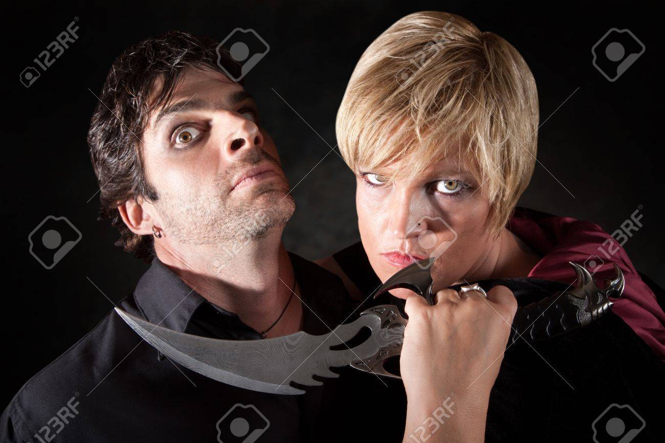 Caucasian woman attacks man with large athame knife Stock Photo - 10553367