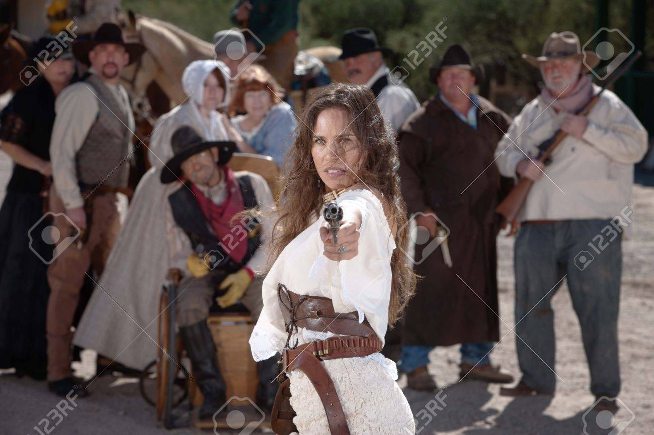 Strong old west woman points her gun defiantly Stock Photo - 13456909