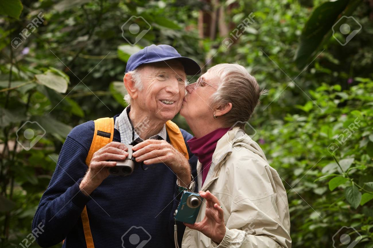 Male and female tourists kissing in the forest Stock Photo - 14022154