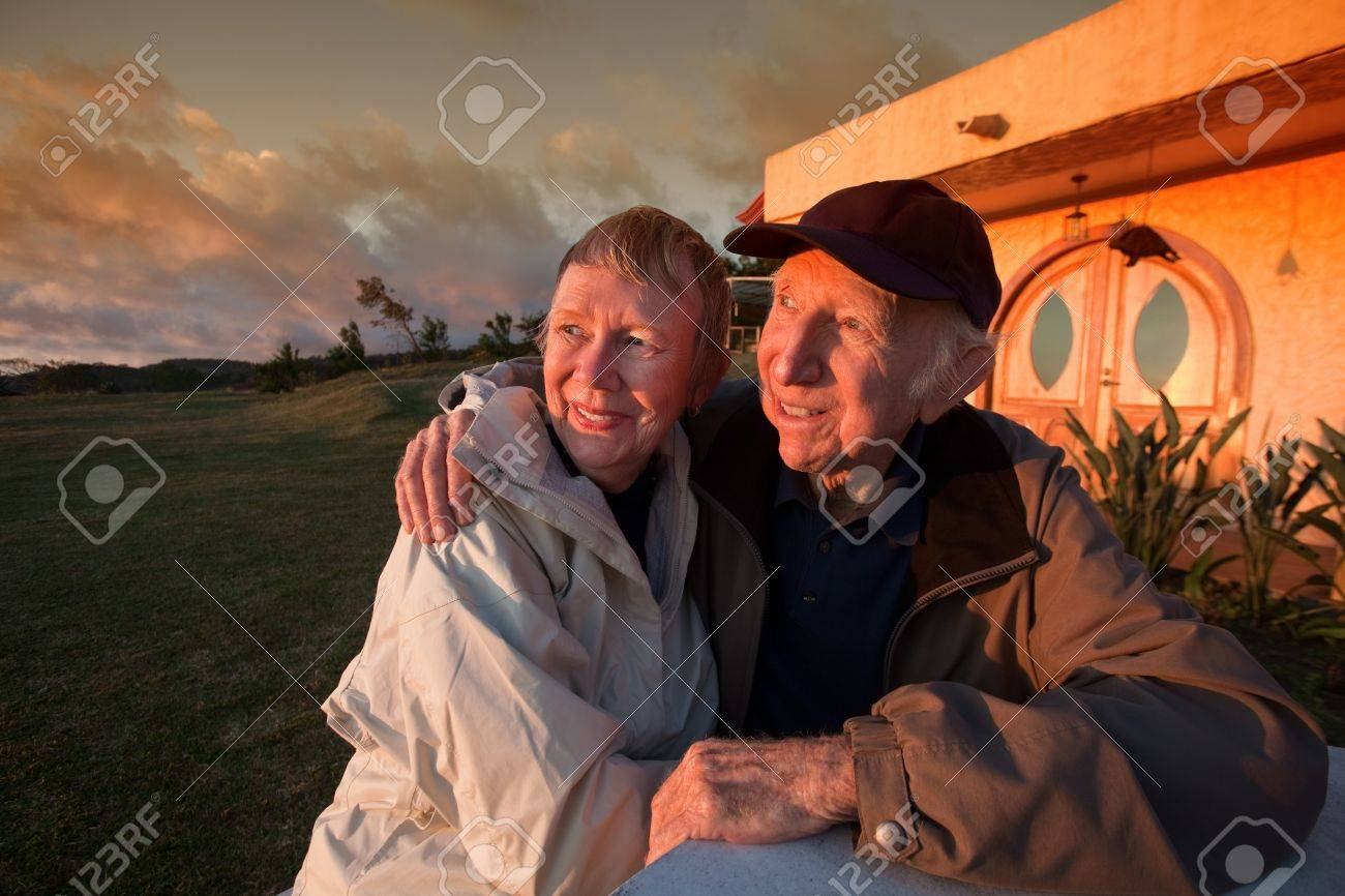 Handsome senior couple looking toward a sunset outside Stock Photo - 14022169
