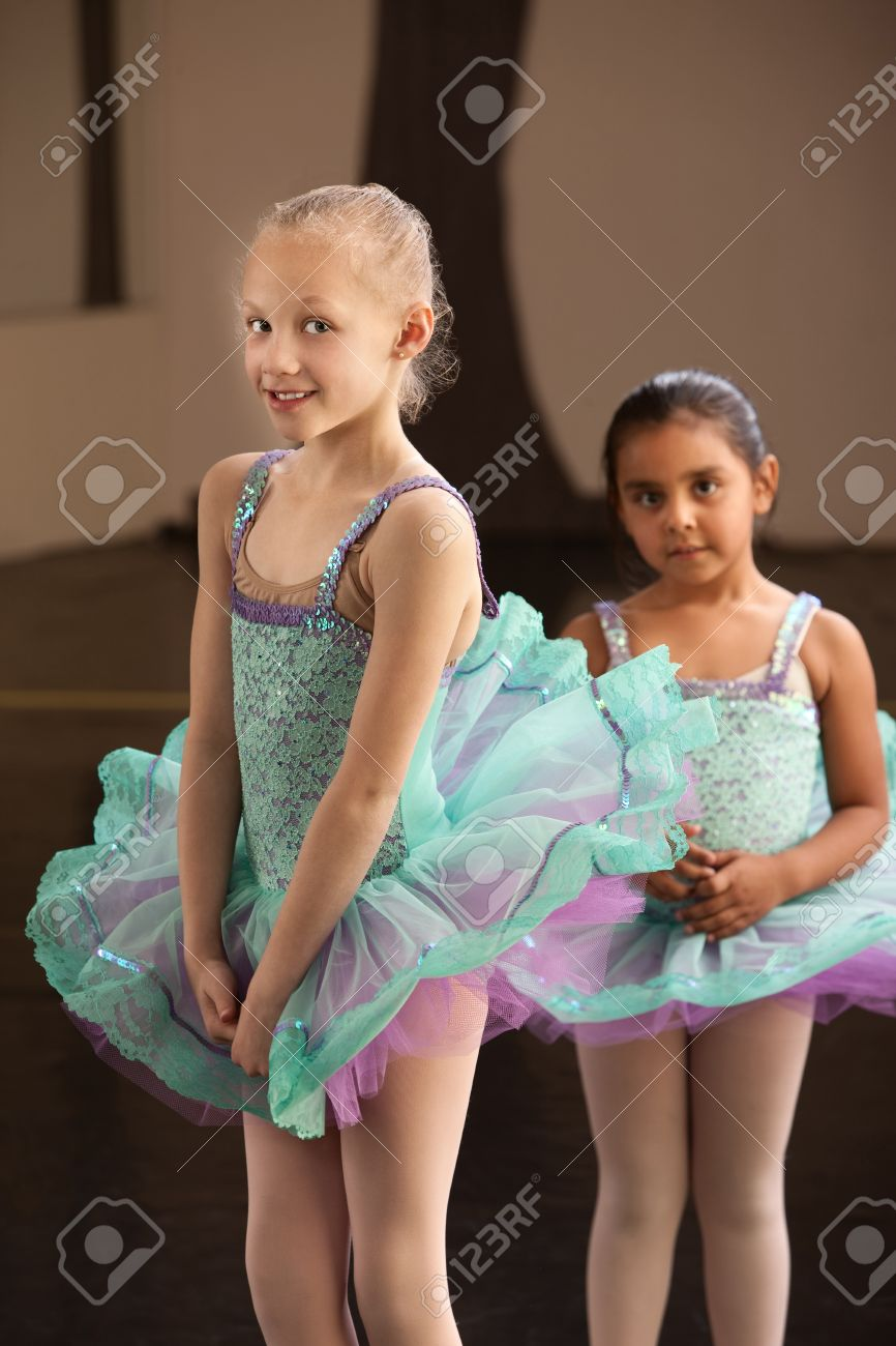 656e699bf682 Shy Little Girls In Ballet Dresses At A Dance Studio Stock Photo ...