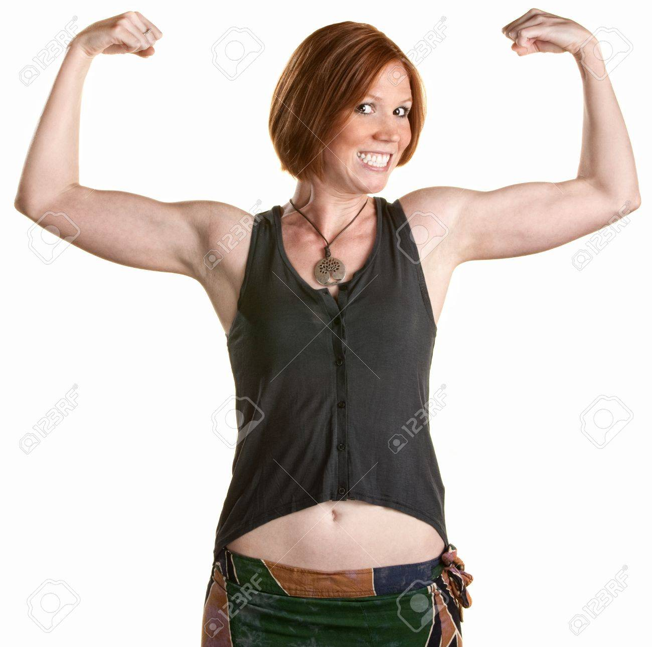 Happy Woman With Smile And Flexing Bicep Muscles Stock Photo