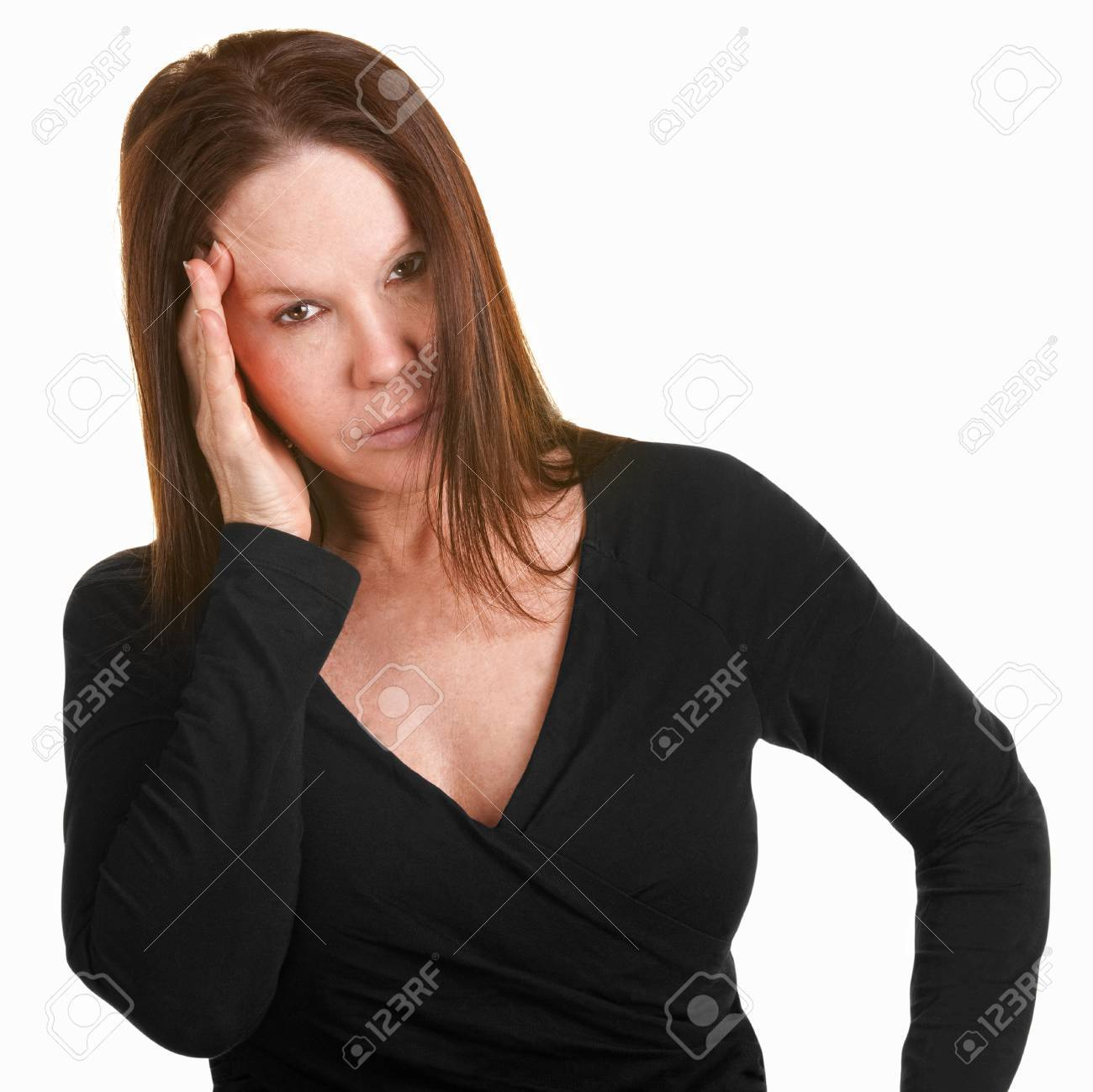 Unhappy European woman in black with hand on head Stock Photo - 15288957