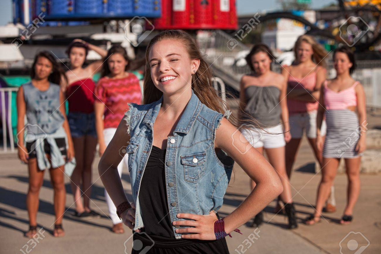 Happy blond teen with big smile in front of friends Stock Photo - 15433193