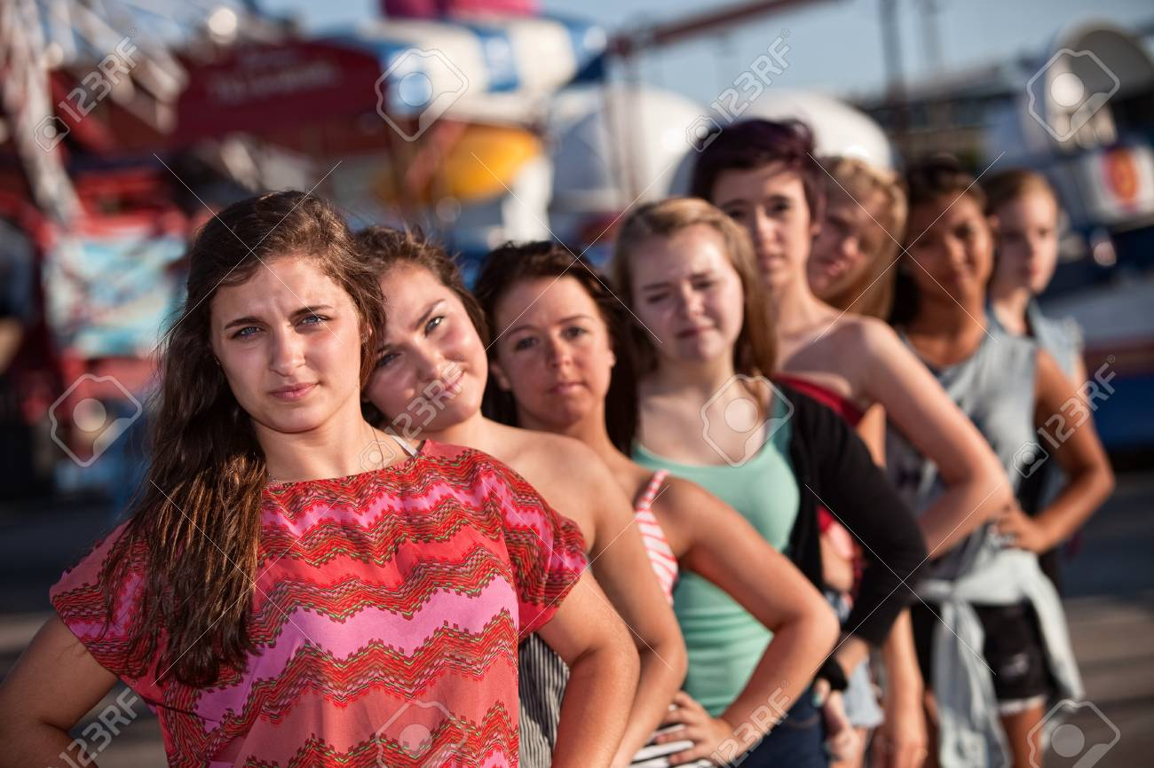 Serious teenage girl with group of friends outdoors Stock Photo - 15433143