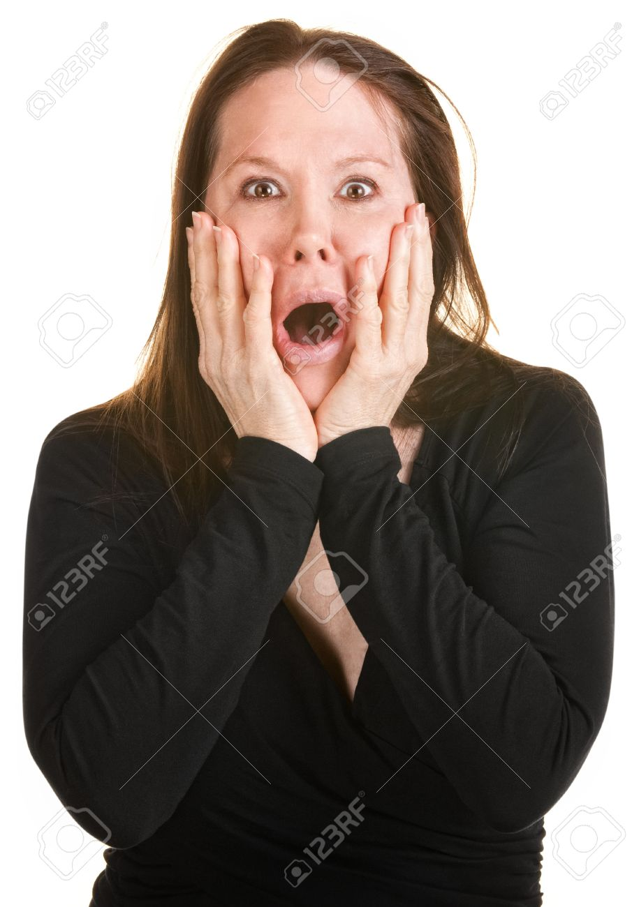 Scared European woman with hands on face over white background Stock Photo - 15433142