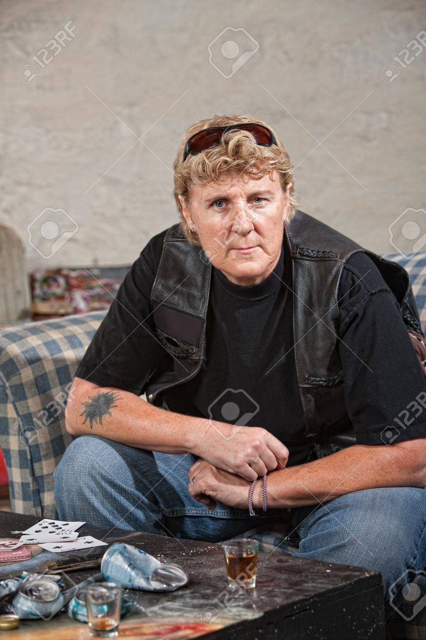 Tough female gang member in black leather jacket and alcohol Stock Photo - 15934645