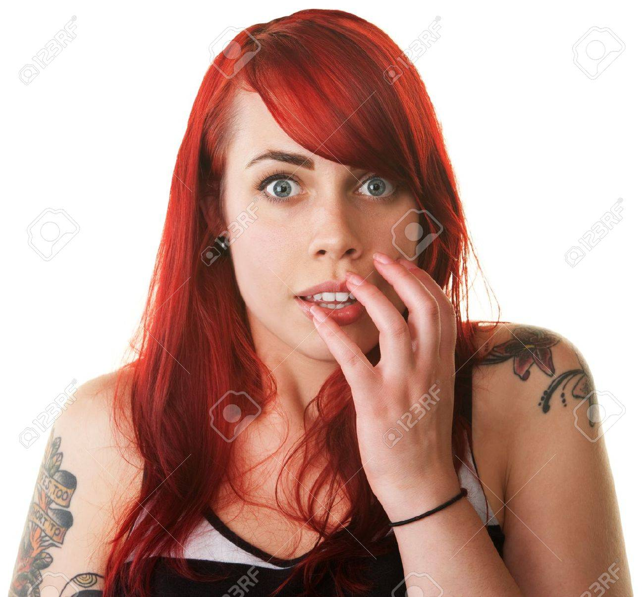 Terrified European lady in red hair and tattoos Stock Photo - 16190287