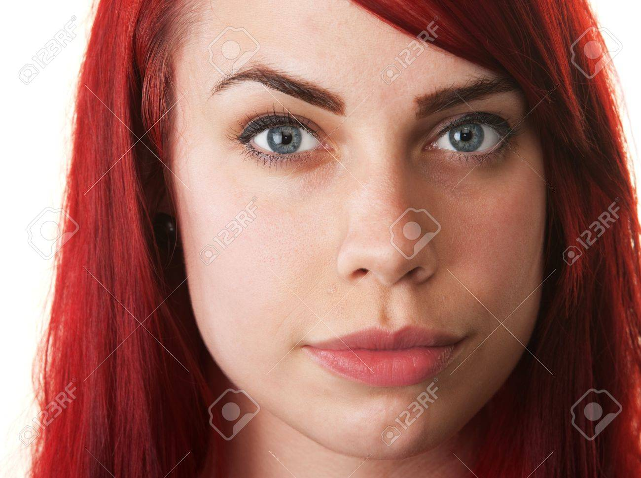 Hopeful young woman with red hair on isolated background Stock Photo - 16190299