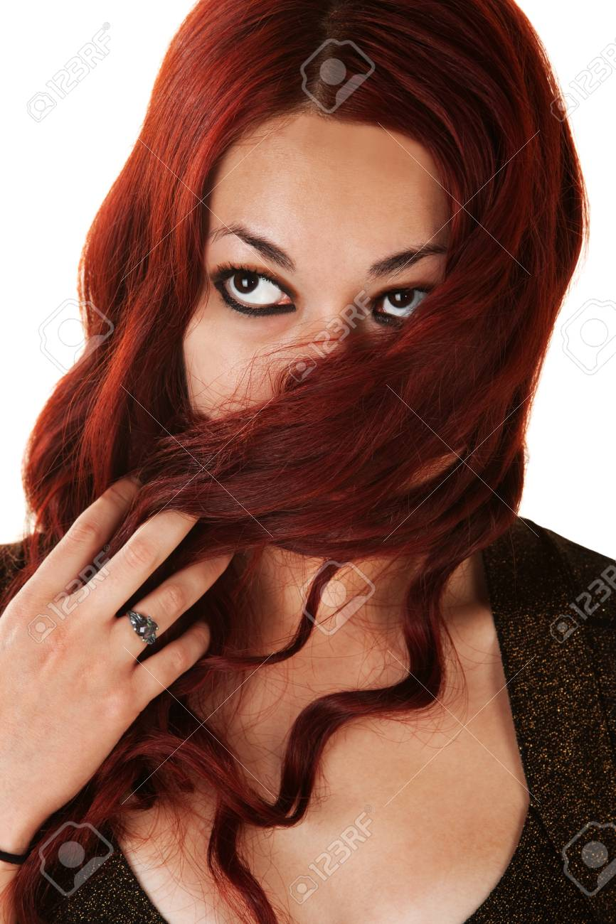Young woman covering her mouth with long red hair Stock Photo - 16300165