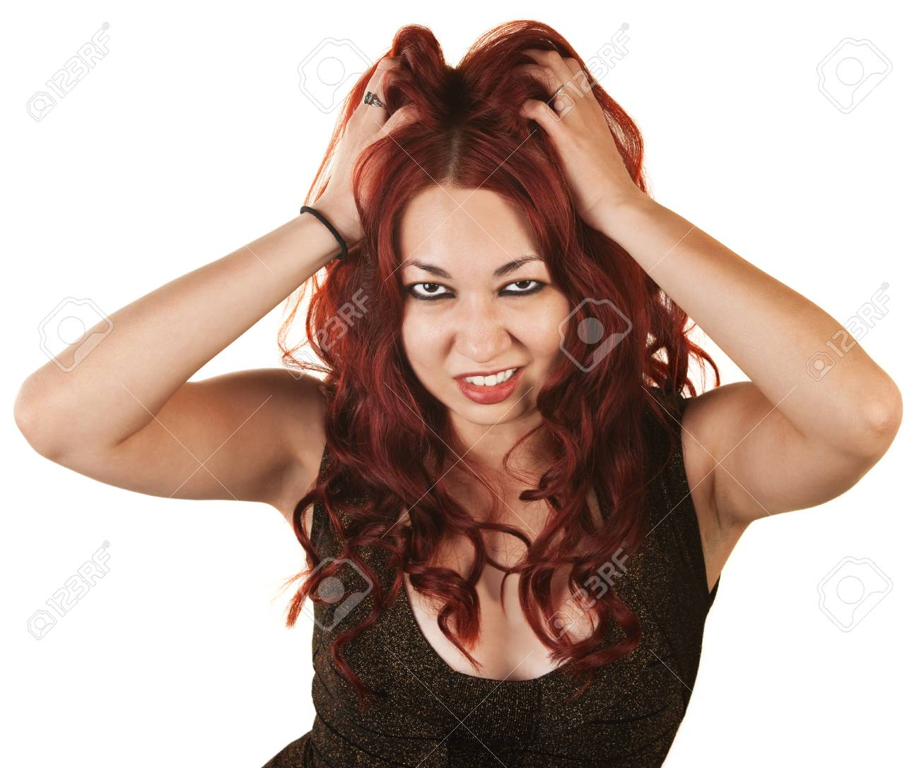 Frowning Latino female on isolated background grabbing her hair Stock Photo - 16300092
