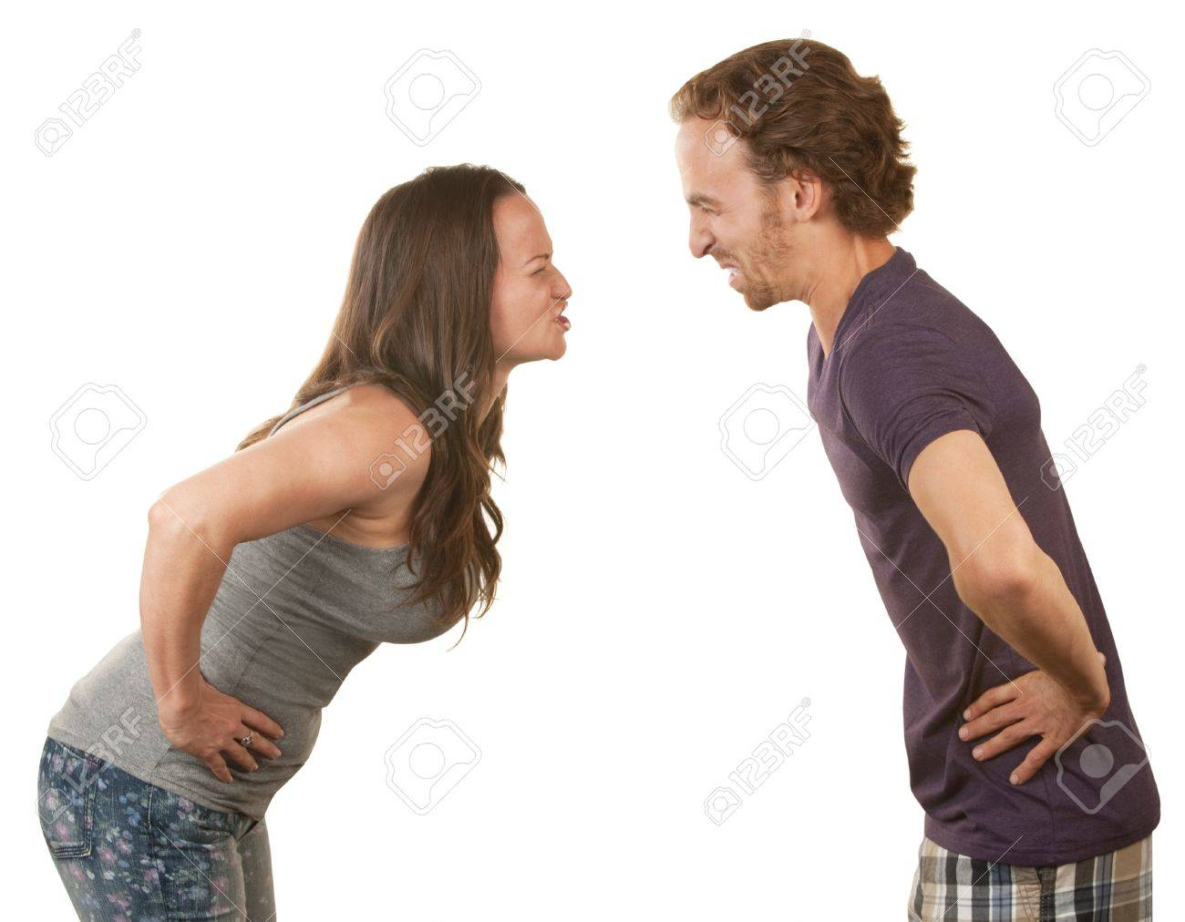 Frustrated spouses closed eyes arguing over isolated background Stock Photo - 16289625