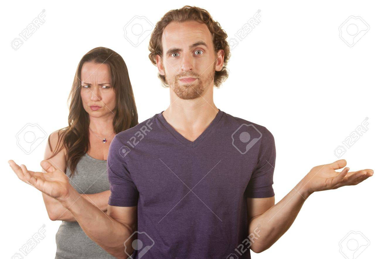 Hopeless man with hands up and suspicious wife Stock Photo - 16300095